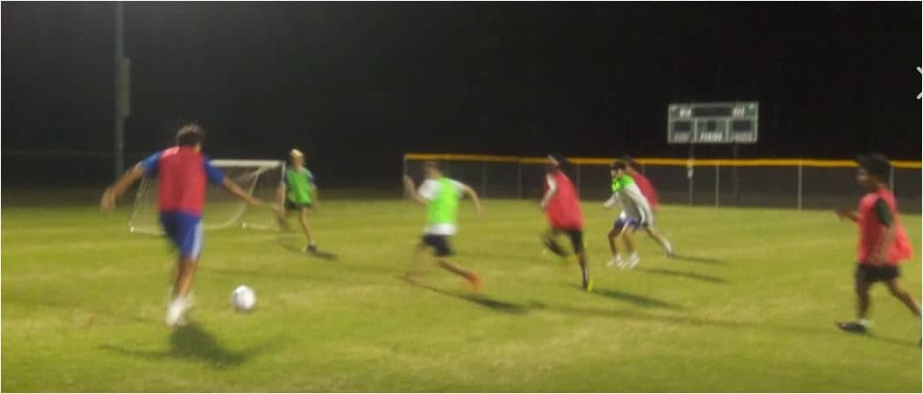 Hope Soccer Ministries Practice under the lights.