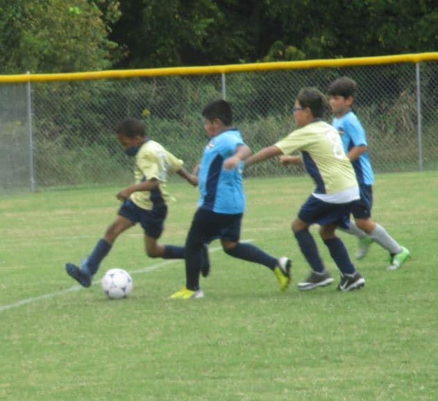 Youth soccer team playing defense in a game