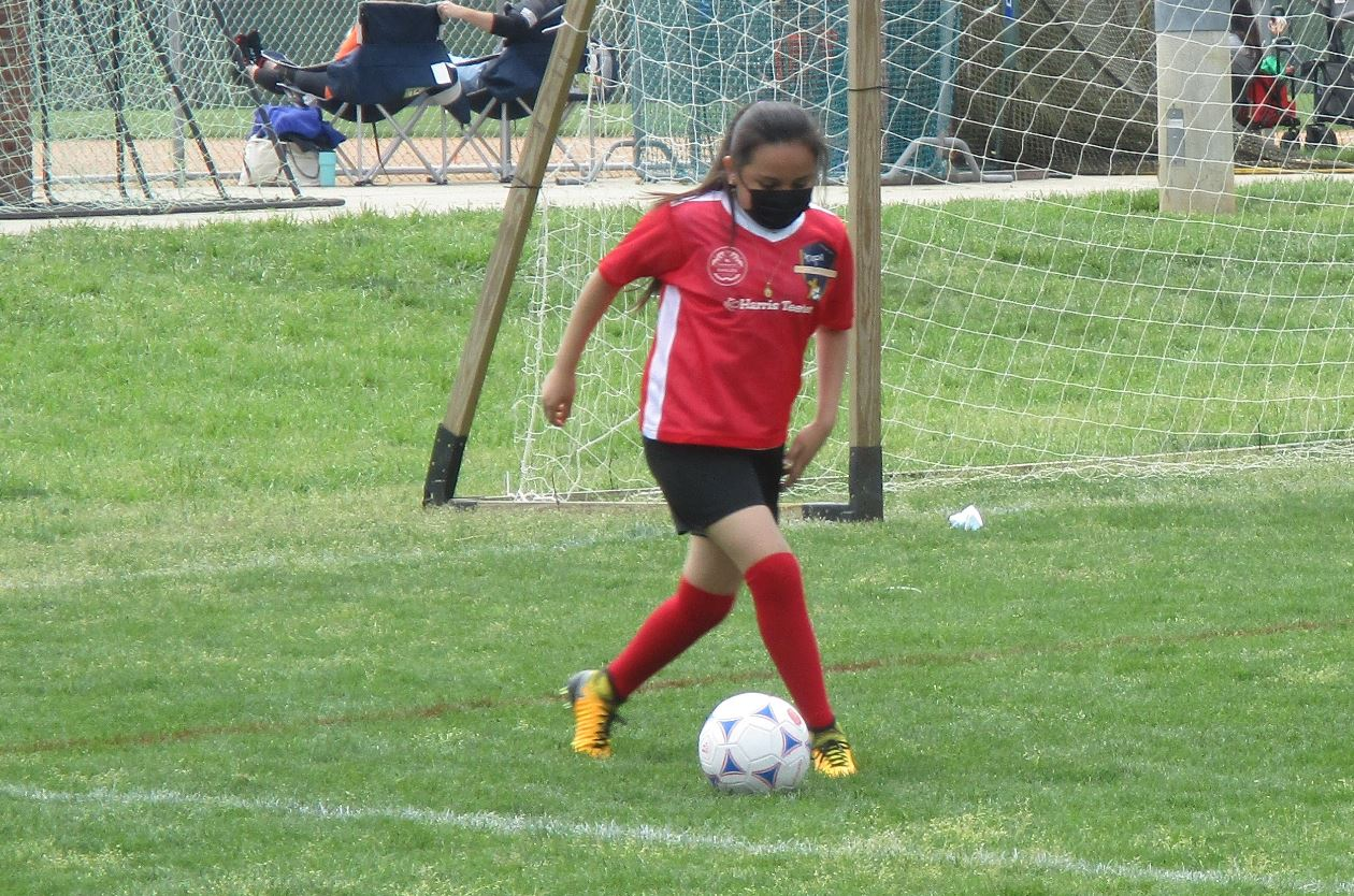 Hope Soccer Player passing the ball.