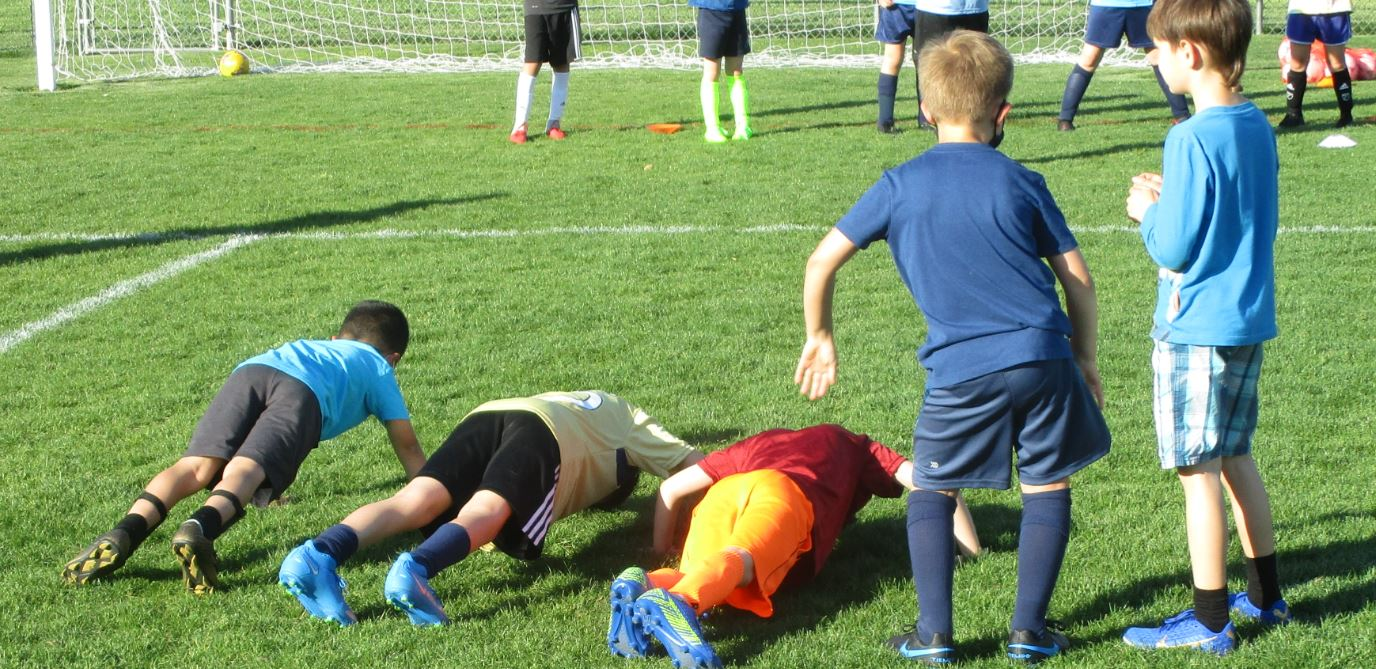 Doing pushups during soccer practice