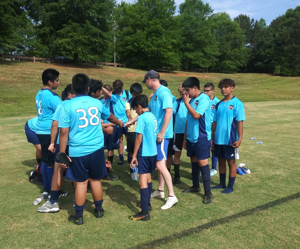 Coach Graham and his soccer team.