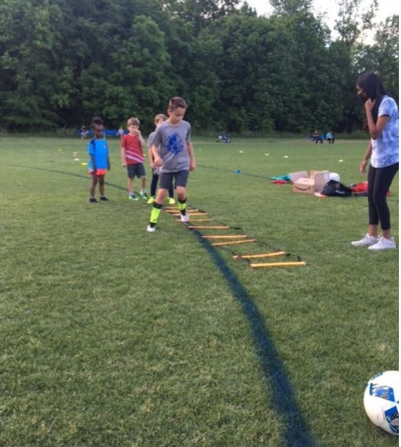 Soccer player doing agility drills.