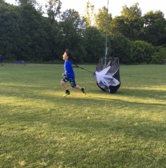 youth soccer player working on his speed.