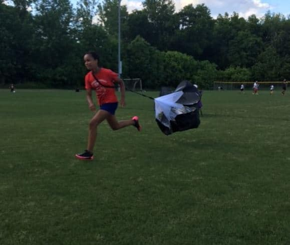 girl soccer player working on her speed.