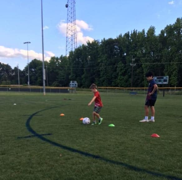 Youth soccer player from Hope Soccer running a drill.